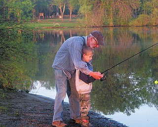 Dan Lynn is teaching his grandson, Nick Holm, how to fish, both live in Youngstown. The picture was taken at Mosquito Creek Lake State Park on May 22.  This was Nick's first time fishing. The photo was submitted by TJ Keiran of Youngstown, Nick's uncle.