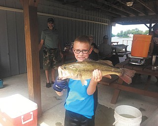 Attached is a picture of my son, Ryan Lamb, 9, of Canfield, with his prize-winning bass caught while trolling with his Papa, Dave Emick (not pictured) at Roaming Shores, Ohio.  Ryan won $25 for the longest bass in this fishing contest.  Photo submitted by Ryan's mom, DeAnne Edwards-Lamb.