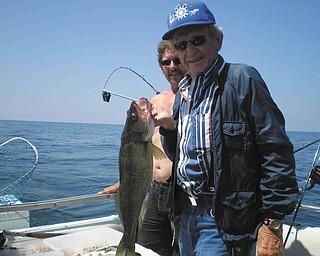 Eddie Krishko of Boardman caught this walleye at Lake Erie. Submitted by Pete Zatvarnicky.