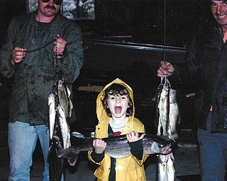Five-year old Beth holds the 28-inch, 7 pound fish that her dad, Mike Fox, and grandpa, Loren Burns, caught on Mother's Day in 1984.