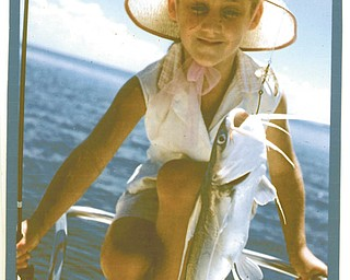 Cindy Wine White, 5, caught her first fish while visiting her grandparents in Florida. Taken by her mom, Joyce Wine of Hubbard.