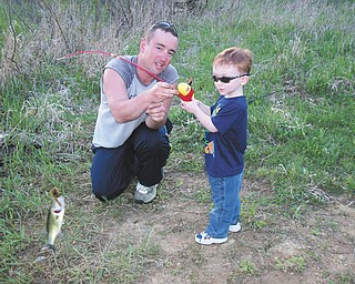 Brad Shultz and his son Peyton on Peyton's first fishing trip on May 3, 2013.  They caught this bass. Both reside in New Middletown, Sent by wife and mother, Shannon.