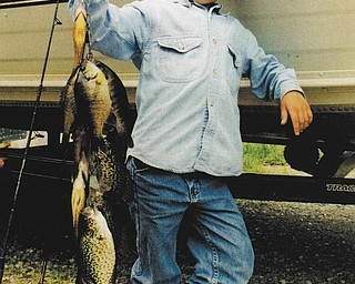 Justin Hoffman, 6, holding the line of fish he and his friend, Jesse Wince caught on a fishing trip with Jesse's father, Mark. The photo was taken by Jesse's mom, Kitty around 1995. All are from North Lima.