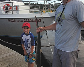 Andy Ward, 6, caught this shark at Myrtle Beach in August 2013.  He refused to hold it, so his dad, Ryan, showed it off for him! Sent by AndyÕs mom, Jen of Poland.