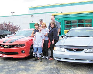 SPECIAL TO THE VINDICATOR Angels of Easter Seals is preparing for its pony car rivalry, which will take place June 14, rain or shine, at Austintown Quaker Steak & Lube. In front is Hunter Crites, Easter Seals client. In the second row are Carol O'Neill, Angels; Nancy Evans, president of the Mahoning Valley Mustangs; and Kathy Carroll, president of Angels. In back are Robert Macabobby, vice president of Mahoning Valley Mustangs, and Morgan Iorio, president of Northeastern Ohio Camaro Club and event chairman.