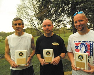 SPECIAL TO THE VINDICATOR Overall winners in the Austintown Lions' 5K Run are, left to right, Tom Grantonic, first place; Don Peace, second place; and Everett Briggs, third place.