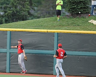 BLOOMINGTON, INDIANA - MAY 30, 2014: Outfielders Kevin Hix #1 and Mike Accardi #2 of Youngstown State react after watching the ball fly over the wall for a 3 run Indiana home run during Friday nights regional tournament game against Indiana University. (Photo by David Dermer/Youngstown Vindicator)