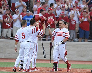 BLOOMINGTON, INDIANA - MAY 30, 2014: Base runner Kyle Schwarber #10 of Indiana is congratulated by teammates #9 Casey Rodrigue, #6 Sam Travis, and #1 Nick Ramos after he hit a 3 run home run during Friday nights regional tournament game against Youngstown State. (Photo by David Dermer/Youngstown Vindicator)