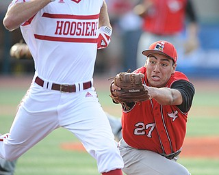 BLOOMINGTON, INDIANA - MAY 30, 2014: Pitcher Jared Wight #27 of Youngstown State dives to attempt to tag out a sprints base runner Tim O'Conner #36 of Indiana, O'Conner would be safe on the play during Friday nights regional tournament game against Indiana University. (Photo by David Dermer/Youngstown Vindicator)