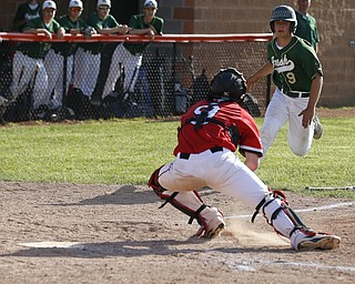 Ursuline's #9 Joel Hake is gunned down at home. Orrville's #9 Layne Scheufler applies the tag.