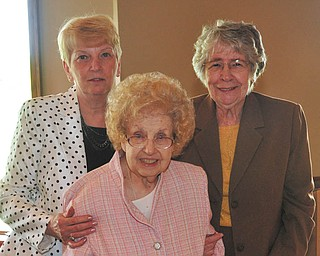 SPECIAL TO THE VINDICATOR In front is Dorothy Schwers, who was recently presented with the Federation Woman of the Year award by the Youngstown Area Federation of Women's Clubs Inc. Behind her are Rusti Puromaki, left, and Elva Easton.