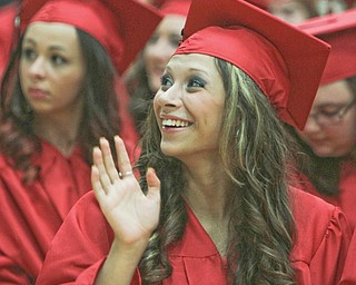 Maria DeAngelis waves to her family in the crowd during the Struthers High School commencement on Sunday afternoon at the high school.