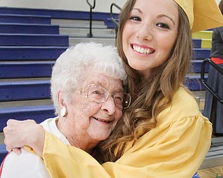 Halle Moran, 2014 Lowellville graduate hugs her great-grandmother, Doris Burns, during Sunday's  commencement ceremony at Lowellville High School. Burns, a 1935 Lowellville High graduate, was introduced at the ceremony as the oldest living Lowellville alumnus.