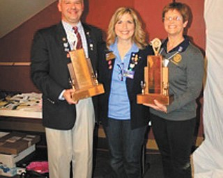 SPECIAL TO THE VINDICATOR At the Annual District Conference in early May, hosted by Rotary Club of Youngstown, the club and several members received awards. Those receiving awards, from left, are Scott Schulick, club president; Debbie Esbenshade, district governor; and Carol Sherman, co-chairwoman of Put Kids First.