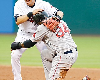 Indians shortstop Asdrubal Cabrera holds onto Red Sox baserunner David Ortiz after Ortiz was out at second base on a double play in the third inning of Monday's game at Progressive Field in Cleveland. A.J. Pierzynski was out at first base.