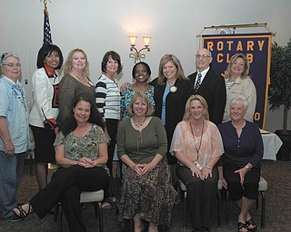 SPECIAL TO THE VINDICATOR Poland Rotary had its annual Chili Open Golf Awards Luncheon on May 14 at Alberini's Restaurant. The club gave money to nine local charities. From left to right, in the front row, are Cathy Kristan and Dawn Dougherty of Mahoning County CASA/GAL, Jodi Harmon of Easter Seals and Debbie Ruehs of Poland Interfaith Pantry. In the back are Kathy Price of Mission of Love, Ruthie King of Boys & Girls Club, Shellie Ducheck of Potential Development, Eileen Larson and Audrey Walker of Sojourner House, Maryann Martinko of Poland Rotary, Mike Iberis of Second Harvest Food Bank and Liz McGarry of Hospice of the Valley.