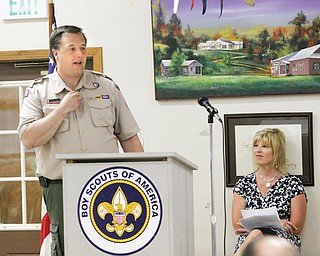 Jason Wolf, executive with the Boys Scouts of America, Greater Western Reserve Council, gives the state of Scouting report at the ninth annual Whispering Pines Friends of Scouting Breakfast at Camp Stambaugh in  Canfield. At right is Stacia Erdos, who served as mistress of ceremonies at Tuesday's fundraiser.