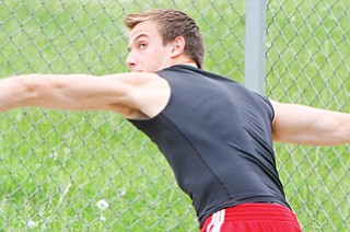 Canfield sophomore Andrew Hallof practices throwing the discus at Wednesday's practice at Canfield High School. He will compete in the event at this weekend's Division I state track and field meet in Columbus.