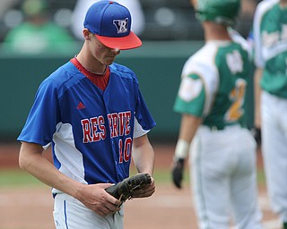 COLUMBUS, OHIO - JUNE 5, 2014: Pitcher Nick Allison #10 of Reserve walks off the field after being pulled from the game in the bottom of the 2nd inning during a OHSAA state semi-final game at Huntington Park. Newark Catholic won 6-2. (Photo by David Dermer/Youngstown Vindicator)