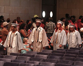 ROBERT K. YOSAY  | THE VINDICATOR.. Leaders of the class of 2014  -Valedictorian  Angel Bell- Salutatorian Ra'Shawn boykin- Melina Kline - gave invocation and Dayna Fletcher class president. East  High School   graduation Friday morning at Stambaugh Auditorium