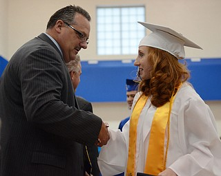 Katie Rickman | The Vindicator  .Valedictorian Victoria Wolfe shakes hands with Jackson Milton Superintendent Kirk Baker after receiving her diploma June 6, 2014.