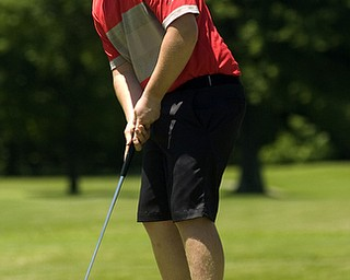 Kelli Cardinal/The Vindicator.Joey Shushok, 15, of Austintown, watches his putt Saturday on the back nine during the Greatest Golfer of the Valley junior series at Mohawk Trails Golf Course in New Castle.