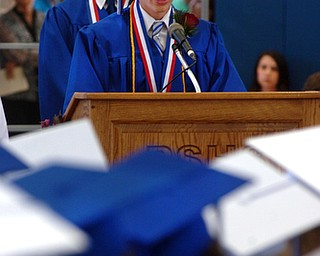 Kelli Cardinal/The Vindicator.Valedictorian Matthew Slaven speaks to his fellow graduates Sunday during the commencement ceremony at Poland Seminary High School.