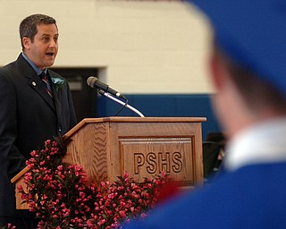 Kelli Cardinal/The Vindicator.Michael Masucci speaks to the graduates, their friends and family Sunday during the commencement ceremony at Poland Seminary High School.