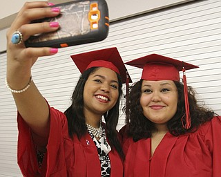 William D Lewis The Vindicator Canfield 2014 grads Queen-Amina Adaego Chijide, left, and Haylee Barker take a selfie before Sunday commencement at CHS.