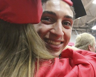 William D Lewis The Vindicator Canfield 2014 grad Kareem Soliman hugs a fellow grad after Sunday commencement at CHS.
