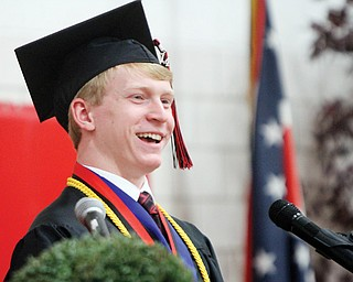 Christopher Halley speaks during commencement exercises Sunday at Canfield High School. He was one of two students selected to address the graduating class based on the new cum-laude honors system.