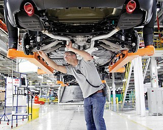 Jeff Caldwell, 29, a chassis assembly-line supervisor, checks a vehicle at the Chrysler Jefferson North Assembly plant in Detroit. The U.S. economy finally regained the jobs lost during the Great Recession, but the comeback is far from complete.