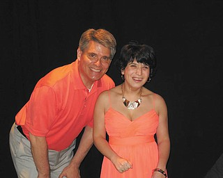 SPECIAL TO THE VINDICATOR Easter Seals wants to thank Angels of Easter Seals for the Breakfast at Tiffany's fundraiser on May 8. Above, Stan Boney and Bianca ham it up, 21 years after first walking together in the show. Bianca, now 22, attends Easter Seals Skill Development Program. Another dynamic duo onstage was Todd Franko and Hunter, who had a surprise up his sleeve. He worked hard for several weeks to show off a milestone — a hop. That was quite a feat for someone who wasn't expected to walk when he was diagnosed.