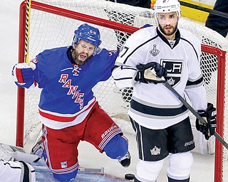 Kings defenseman Alec Martinez looks away as Rangers right wing Martin St. Louis celebrates scoring a goal in the second period of Game 4 of the Stanley Cup Final on Wednesday in New York. The Rangers held on to win 2-1 and avoid a sweep. Game 5 is set for Friday in Los Angeles.