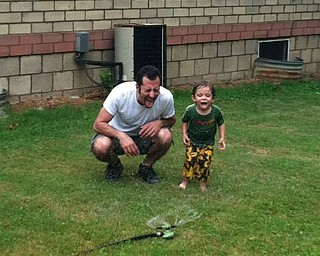Tony Chance of Sharpsville, Pa., enjoyed Father's Day in 2013 with his son Jack Chance, 2. This was the first time Jack went under the sprinkler and he and his dad had a blast! Sent by Mary Ellen Chance of Youngstown.
