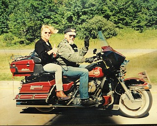 "Lori Gerner of East Palestine says, ""The best way to see these United States is on a Harley,"" riding with her dad, Chuck Cavanaugh of New Middletown."