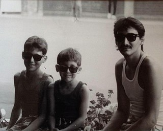 Josh Morales of Campbell and Branden Morales of Boardman with their father, Andres Morales of Campbell, enjoyed a visit to Sea World  on June 22, 1986.