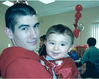 John J. Vanca is with his son Luke in 2005 on Luke's first birthday. Both reside in Campbell.