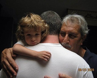 Luca Comichisto, now 8, and his father Christofer Comichisto. They live in Cortland. Grandfather is Lio Comichista of Girard. Sent by grandmother, Bice Comichista.