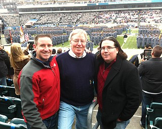 Jerry McNally of Youngstown, center, with sons Sean McNally of Powell, Ohio, left, and Breen McNally, also of Youngstown, at the annual Army/Navy football game in Philadelphia. Breen and Sean took their father to the game for his birthday. They also celebrated BreenÕs upcoming wedding.