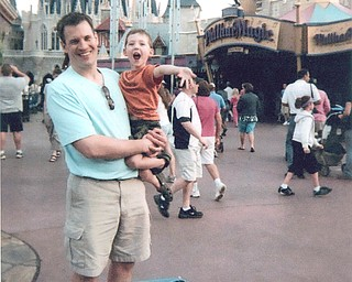 Patrick Huly with his son, Ethan, at the Magic Kingdom.
