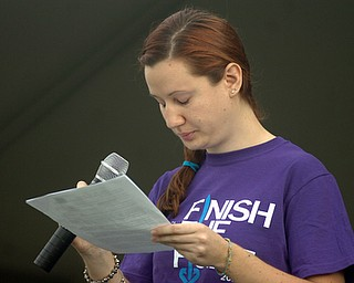 Kelli Cardinal/The Vindicator.Nicole Novotny, 23, of Youngstown, pauses before thanking her parents Friday while speaking about her own battle with cancer during the 2014 Austintown Relay For Life event in Austintown Township Park.  Novotny was diagnosed with Non Hodgkin's Lymphoma at age 19.