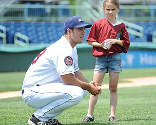 Mahoning Valley Scrapper pitcher J.P. Feyereisen, a recent draftee, talks with Madison Bucko, 9, of Austintown, Thursday during the team's media day at Eastwood Field in Niles. Madison will throw out the first pitch at the team's home opener Tuesday against the Auburn Doubledays. The season opener is tonight against the Jammers in Jamestown, N.Y.