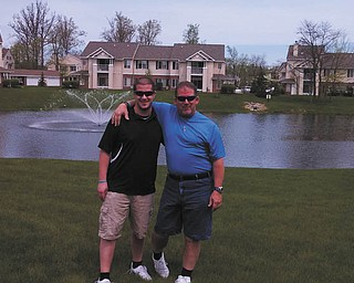 Chad Burbrink of Fort Wayne, Ind., is shown with his father Steve Burbrink of Canfield.