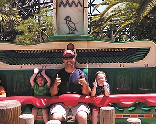 CONGRATULATIONS TO THE WINNER: It's thumbs-up for Kurt DiLisio and his two sons, Gino, 5, and Rocco, 7, as they get ready to ride the Beetle Bounce during a visit to Legoland in April 2013. Kurt's wife, Jennifer, submitted the winning photo. The family lives in Canfield. As the winners of this year's photo drawing, the guys will share $100 in gift certificates from the Mahoning Valley Scrappers, good toward the purchase of game tickets, merchandise and food.
