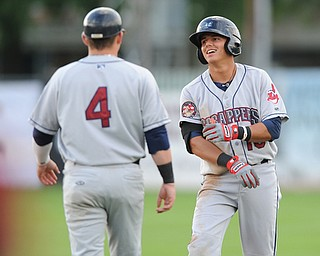 JAMESTOWN, NEW YORK - JUNE 13, 2014: Base runner Yonathan Mendoza #10 of the Scrappers is congratulated by first base coach Shane Rowland after a RBI single in the top of the first inning to make the score 2-0 scrappers during a game at Russell Diethrick Park. (Photo by David Dermer/Youngstown Vindicator)