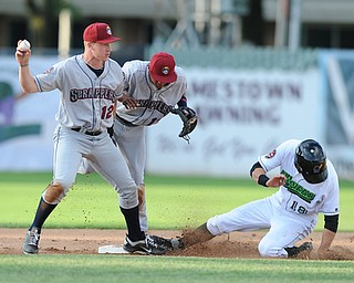 JAMESTOWN, NEW YORK - JUNE 13, 2014: Infielder Austin Fisher #12 of the Scrappers steps on second base to force out baserunner Carl Anderson #18 of Jamestown for the 1st out, while being ran into by teammate Ordomar Valdez #11 in the bottom of the 1st inning during a game at Russell Diethrick Park. (Photo by David Dermer/Youngstown Vindicator)