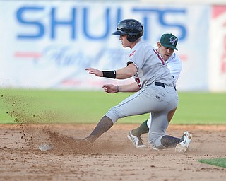 JAMESTOWN, NEW YORK - JUNE 13, 2014: Base runner Austin Fisher #12 of the Scrappers slides into second base to beat the tag of infielder Erik Lunde #6 of Jamestown during the top of the 2nd inning during a game at Russell Diethrick Park. (Photo by David Dermer/Youngstown Vindicator)