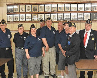SPECIAL TO THE VINDICATOR American Legion Post 236 of Newton Falls installed new officers for 2014-2015. From left to right are Vic Sibera, first vice commander; Walt Tully, chaplain; Donna Ball, finance officer-historian; Albert Mason, adjutant; Joe Ball, commander; Joe Nicolino, service officer; and Darryl Brown, sergeant-at-arms. Officiating the ceremony were Ron Curry and Roger Gardner. Also installed was Steve Garcar, second vice commander.