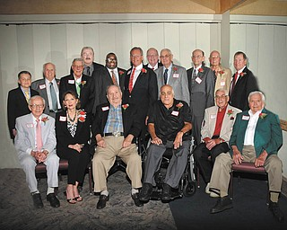 SPECIAL TO THE VINDICATOR Woodrow Wilson High School had its first Hall of Fame event on May 25 at the Georgetown in Boardman. More than 300 people attended. Jacquelyn Gawron was honored with the Hall of Fame Award, given posthumously. Recipients of the 2014 Legacy Scholarship are Taylor Minenok, daughter of Wilson alumnus Russell Minenok; and Simone Gant, daughter of Francine Congemi, Wilson alumnus. Attending the banquet, in the front row, from left, were Howdy Friend, Judge Cheryl Waite, Tony Chiarello, Tony D'Apolito, Thomas Constantinovich and Gene Horvath. In the back row are Alex Slezak, son of Victor Slezak; Frank Kreps; Dr. Don DeCenso; Bill Young; the Rev. Lewis Macklin; Judge Robert Milich; Dr. Rudy Braydich; Steve Farkas; Parker McHenry; Richard Gross; and Richard Banks.
